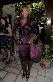 Serena opted for a satin, deep purple skirt suit with ruffled detailing.