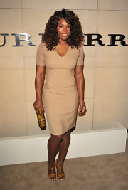 Serena Williams added just the right amount of color to her sexy nude dress with a mustard leather clutch.
