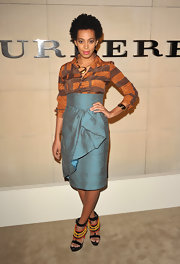 Solange Knowles added pep to her step with platform sandals complete with orange and yellow beaded detailing.