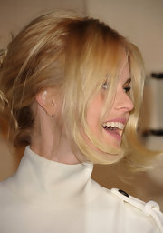 Alice Eve left some pretty face-framing layers out of her simple updo at the Burberry Body launch.