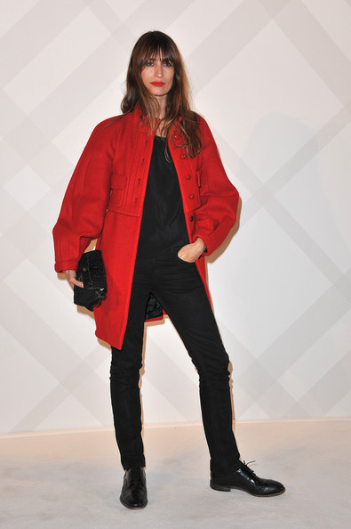 Carline De Maigret struck a fierce pose in a red wool coat with oversize sleeves.
