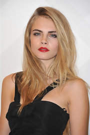 Cara Delevingne looked gorgeous with red lips as she attended Burberry's boutique opening at British Embassy.