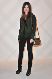 Lou Lesage looked effortlessly stylish in an olive cardigan with a peplum waist.