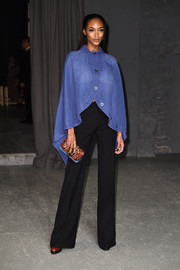 Jourdan Dunn teamed her cape with on-trend wide-leg pants.