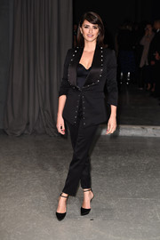 Penelope Cruz worked a studded black pantsuit by Burberry during the label's fashion show.