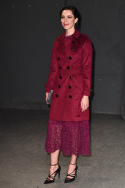 Rebecca Hall was classic and smart in a wine-red trenchcoat while attending the Burberry fashion show.