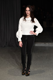 A pair of Burberry jeans, in black with white stitching, finished off Kaya Scodelario's outfit.