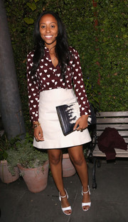 Shiona Turini opted for simple white ankle-strap sandals to finish off her look.