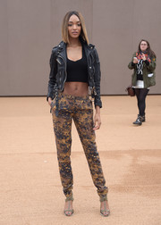 Jourdan Dunn was equal parts edgy and sexy in a black Burberry leather jacket layered over a crop-top during the brand's fashion show.