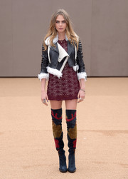 Cara Delevingne amped up the edge factor with a pair of colorful Burberry thigh-high boots.