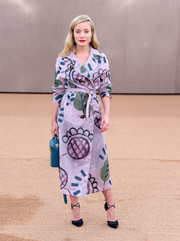 Kate Foley was eye candy in a whimsical-print trenchcoat by Burberry during the brand's fashion show.