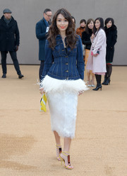 Marion Caunter wore a figure-hugging denim jacket to the Burberry fashion show.