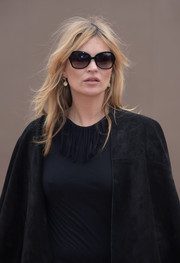 Kate Moss arrived for the Burberry fashion show sporting a chic pair of butterfly sunnies.