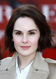 Michelle Dockery is known for her classic English rose style on 'Downton Abbey.' The star stuck to what she knows with a light pink lip at the Burberry Prorsum runway show.