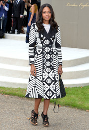 Naomie Harris paired her coat with black cage booties, also by Burberry Prorsum.