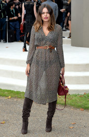 Atlanta de Cadenet Taylor opted for dark gray knee-high boots to complete her look.