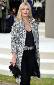 Kate Moss accessorized with a fringed suede clutch by Burberry when she attended the label's fashion show.