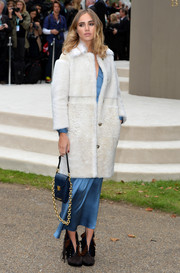 Suki Waterhouse arrived for the Burberry Prorsum fashion show wearing a white teddy bear coat over a blue silk dress.