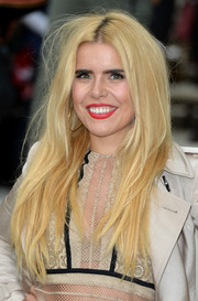 Paloma Faith wore her long hair down with a center part during the Burberry Prorsum fashion show.