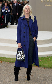 Poppy Delevingne teamed her coat with fringed suede boots.