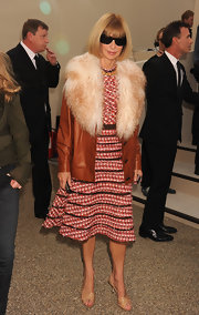 Anna Wintour topped her Chanel tweed dress off with a leather and fur clad jacket.