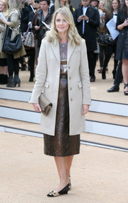 Donna Air arrived at the Burberry Prorsum fashion show wearing a nude wool coat over a leather top and a snakeskin skirt.