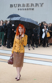 Paloma Faith looked super stylish in a brown leather pencil skirt and a mustard trenchcoat at the Burberry Prorsum fashion show.