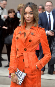 Jourdan Dunn's spiky gold bracelet and orange trenchcoat at the Burberry fashion show were a fierce pairing.