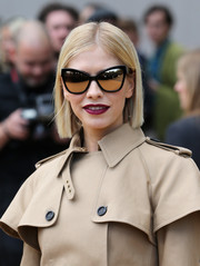 Leigh Lezark looked flawless with her sleek bob and cat-eye sunnies at the Burberry Prorsum fashion show.