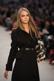 Cara Delevingne was holding a studded striped tote on the Burberry Prorsum runway.