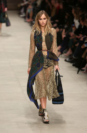 Suki Waterhouse showed plenty of skin in a see-through nude lace dress while walking the Burberry Prorsum runway.