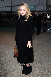 Mary-Kate Olsen dressed in Burberry arrives at the Burberry Prorsum Spring/Summer 2010 in support of the designer.