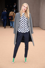 Poppy Delevingne added a pop of color with a pair of bright green Burberry sandals at the Burberry Autumn/Winter 2014 show.