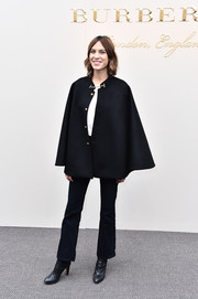 Alexa Chung kept the rest of her look casual with a pair of black bootcut jeans and a white shirt.