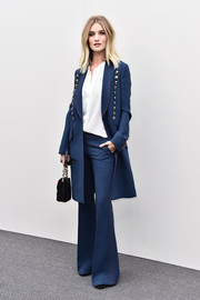 Rosie Huntington-Whiteley suited up in this blue military coat and flared pants combo by Burberry for the label's fashion show.