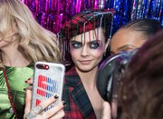 Cara Delevingne's Christmas party makeup would look just as appropriate for Halloween!