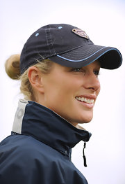 Zara Phillips kept it casual in a baseball cap at the Burghley Horse Trials.