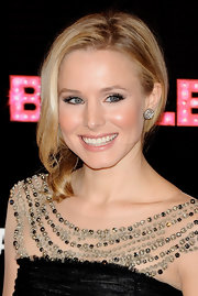 Actress Kristen Bell completed her elegant loose bun with stunning 14-karat gold and diamond earrings.