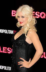Christina Aguilera added some volume to her blond curls with a half up half down hairdo.