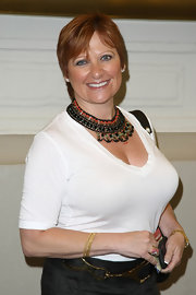 Caroline Manzo dressed up a simple white tee with an elaborate beaded collar necklace at the 'Burn the Floor' Broadway opening.