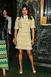 Priyanka Chopra-Jonas styled her look with a pair of clear and white boots, also by Chanel.