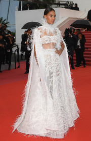 Cindy Bruna looked magnificent in a caped, embroidered white gown by Ashi Studio Couture at the Cannes Film Festival screening of 'Burning.'