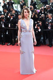 Milla Jovovich looked simply elegant in a beaded gray column dress by Prada at the Cannes Film Festival screening of 'Burning.'