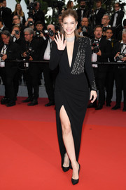 Barbara Palvin went the edgy-elegant route in a deep-V wrap gown by Alberta Ferretti at the Cannes Film Festival screening of 'Burning.'