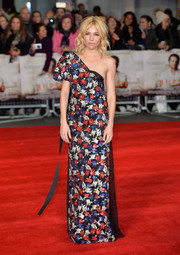 Sienna Miller looked modern and vibrant at the European premiere of 'Burnt' in a Marc Jacobs one-shoulder gown rendered in red, blue, and silver sequins.