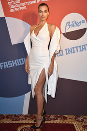 Irina Shayk showed off her flawless figure in a fitted white halter dress at the Buro 24/7 Fashion Forward Initiative.