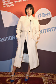 Eva Chen arrived for the Buro 24/7 Fashion Forward Initiative wearing a stylish white coat.