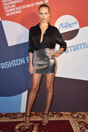 Natasha Poly paired her sexy skirt with a black satin button-down.