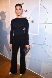 Nicole Warne went modern in a navy boatneck sweater with side cutouts for the Fashion Forward Initiative dinner.