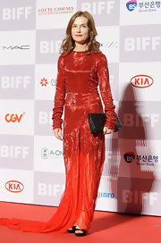 Isabelle Huppert looked dazzling in a glittery red evening dress with a chiffon train at the Busan International Film Festival.